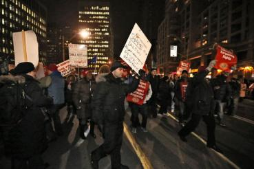 Toronto Elementary and Secondary teachers block Bay St. in protest (via the Toronto Star).